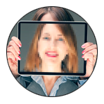 A woman holding an ipad in front of her face.