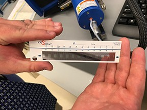 hands holding test forensic strip