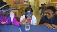 Photo of 3 students doing a science activity