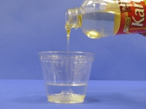 Pouring corn syrup into water