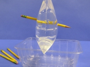 Pencil all the way through a plastic bag of water.