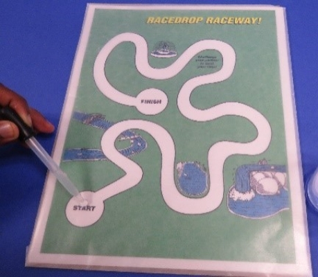 putting-water-on-racedrop-raceway-board