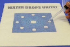 putting-water-on-water-drops-unite-board