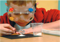 Boy wearing goggles looking at an experiment