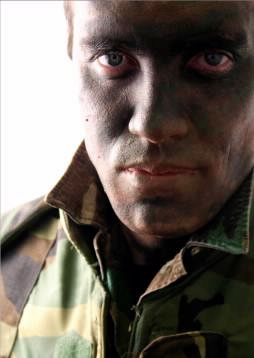 soldier in camouflage makeup