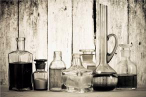 Chemistry bottles and jars containing substances.