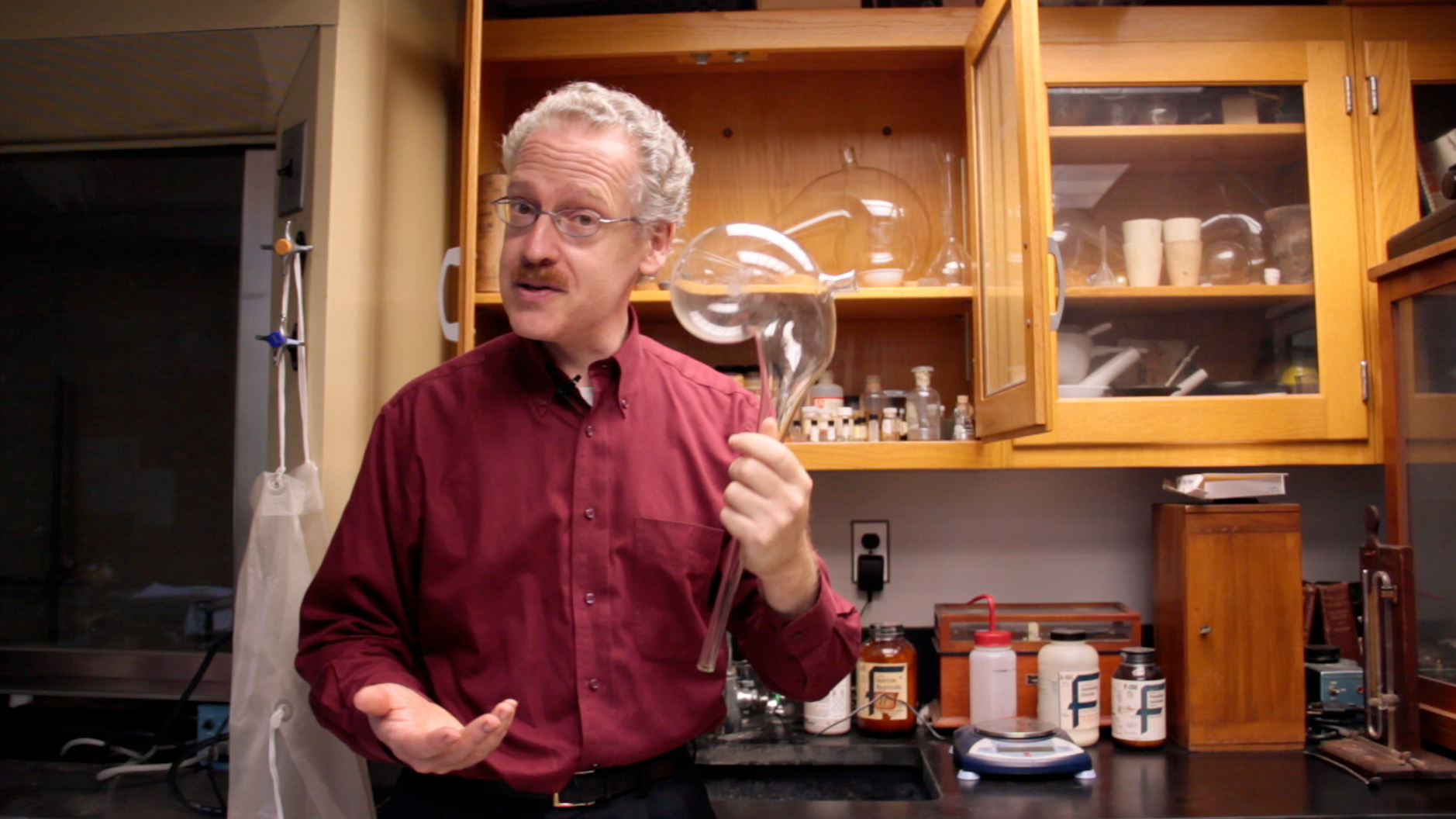 Scientist with chemistry glassware