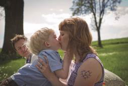 Jonah Weishaar, who has Sanfilippo syndrome, type C, with his mother.